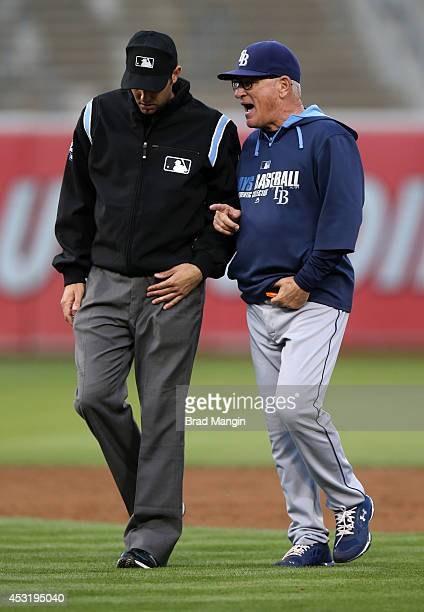 Manager Joe Maddon of the Tampa Bay Rays talks with umpire John Tumpane during the game against the Oakland Athletics at Oco Coliseum on Monday...