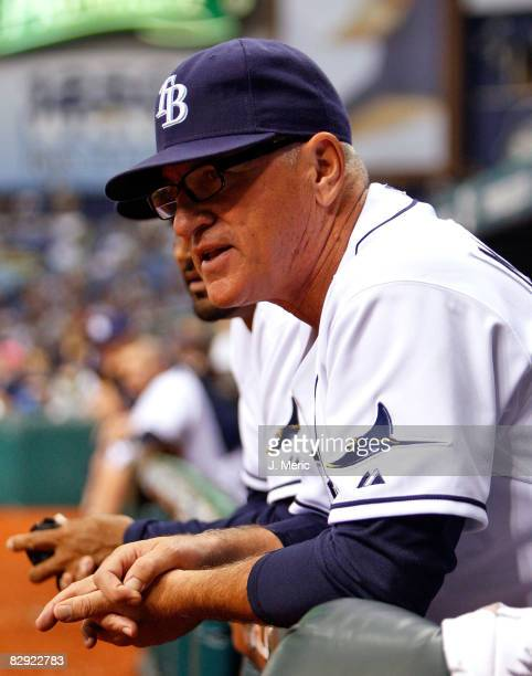 Manager Joe Maddon of the Tampa Bay Rays watches his team from the dugout against the Minnesota Twins during the game on September 19 2008 at...