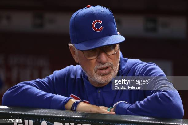 Manager Joe Maddon outfield the Chicago Cubs watches from the dugout during the first inning of the MLB game against the Arizona Diamondbacks at...