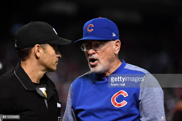 Manager Joe Maddon the Chicago Cubs has a few words for home plate umpire Mark Wegner after a third called strike on Kris Bryant to the end of the...
