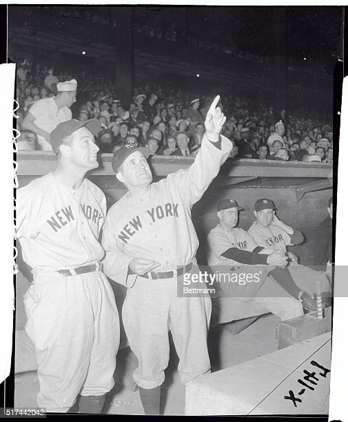 Manager Joe McCarthy of the New York Yankees seems to be pointing out the pretty stars to team captain Lou Gehrig before start of tonight's game with...