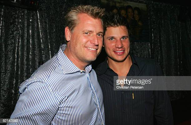 Manager Joe Simpson and tv personality Nick Lachey pose for a photograph at Super Bowl Playboy Party at the River City Brewing Company on February 5,...