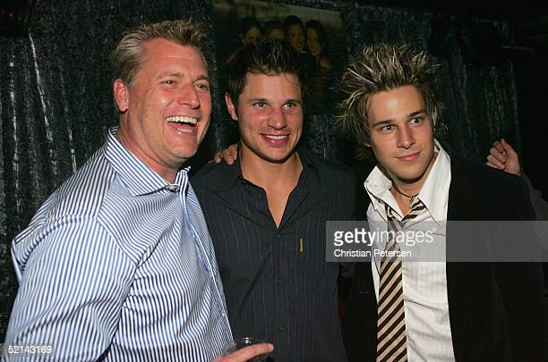Manager Joe Simpson, Nick Lachey and singer Ryan Cabrera pose for a photograph at Super Bowl Playboy Party at the River City Brewing Company on...