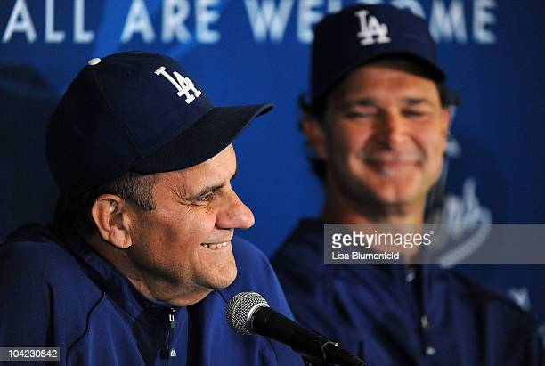 Manager Joe Torre and coach Don Mattingly of the Los Angeles Dodgers attend a press conference announcing that Mattingly will manage the Dodgers in...