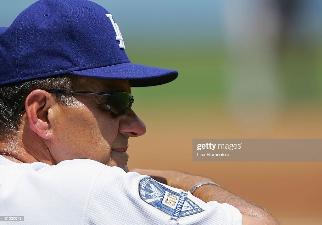 Manager Joe Torre of the Los Angeles Dodgers looks on from the dugout durng the game against the Colorado Rockies at Dodger Stadium on April 27, 2008 in Los Angeles, California.