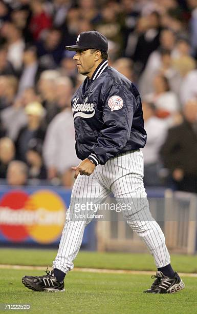 Manager Joe Torre of the New York Yankees walks to the mound during the game against the Boston Red Sox on May 10, 2006 at Yankee Stadium in the...