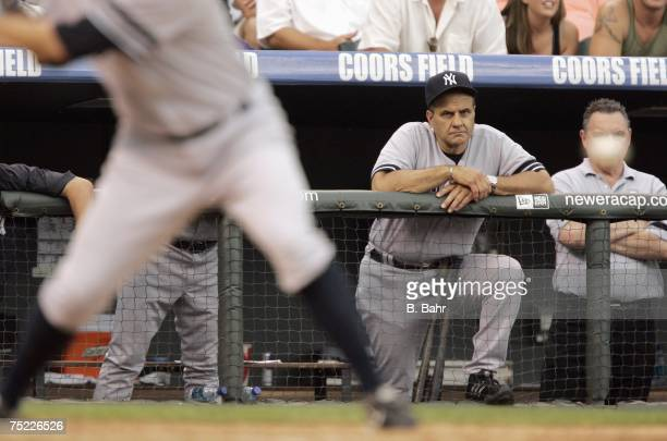 Manager Joe Torre of the New York Yankees watches from the bullpen against the Colorado Rockies on June 21 2007 at Coors Field in Denver Colorado The...