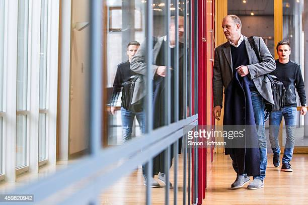 Manager Joerg Schmadtke and Slawomir Peszko of 1 FC Koeln arrive prior to the decision of DFB Court on the objection to the length of a 3 match ban...