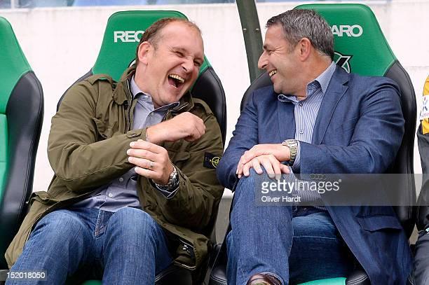 Manager Joerg Schmadtke of Hannover and Manager Klaus Allofs of Bremen laugh before the 1 Bundesliga match between Hannover 96 and Werder Bremen at...