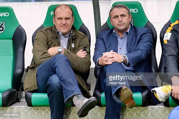 Manager Joerg Schmadtke of Hannover and Manager Klaus Allofs of Bremen looks on before the Bundesliga match between Hannover 96 and Werder Bremen at...