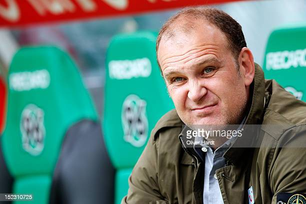 Manager Joerg Schmadtke of Hannover looks on before the during the 1 Bundesliga match between Hannover 96 and Werder Bremen at AWD Arena on September...