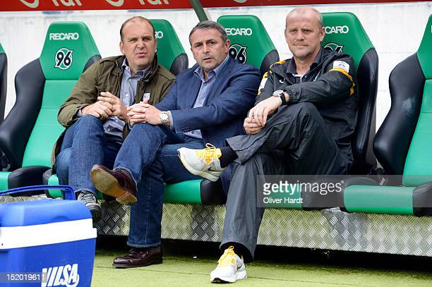 Manager Joerg Schmadtke of Hannover Manager Klaus Allofs of Bremen and head coach Thomas Schaaf looks on before the Bundesliga match between Hannover...