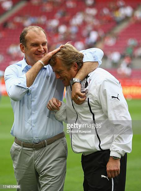Manager Joerg Schmadtke of Koeln and head coach Mike Bueskens of Duesseldorf come together prior to the Second Bundesliga match between 1 FC Koeln...