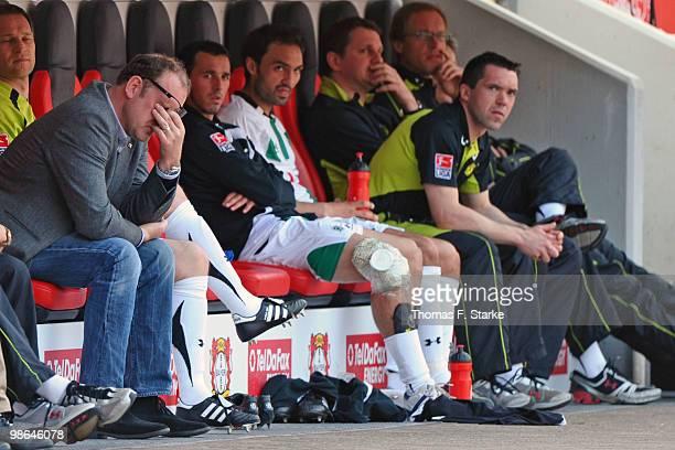 Manager Joerg Schmadtke sits dejected on Hannovers substitutes bench during the Bundesliga match between Bayer Leverkusen and Hannover 96 at BayArena...