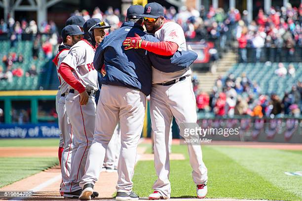 Manager John Farrell greets David Ortiz of the Boston Red Sox on the field prior to the game against the Cleveland Indians the opening day game at...