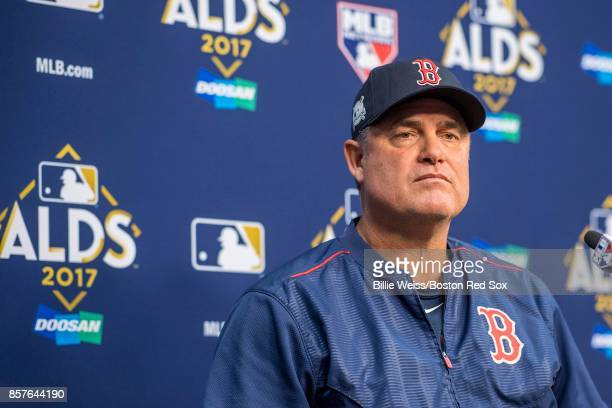 Manager John Farrell of the Boston Red Sox addresses the media during a press conference during a workout before the American League Division Series...