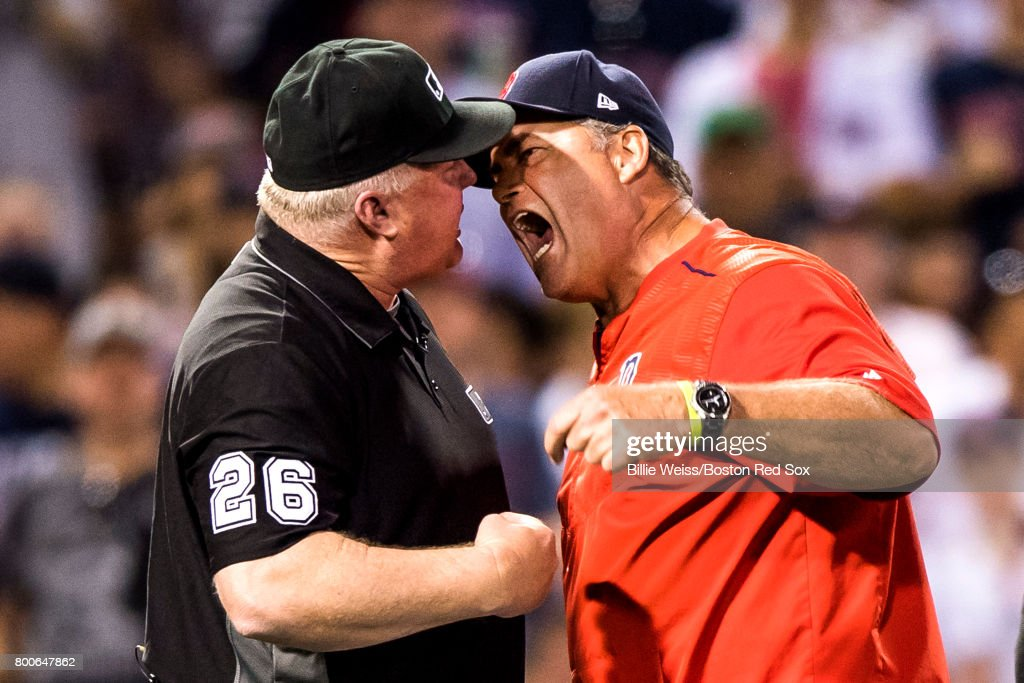 Manager John Farrell of the Boston Red Sox argues a balk call with the umpire Bill Miller during the seventh inning of a game against the Los Angeles Angels of Anaheim on June 24, 2017 at Fenway Park in Boston, Massachusetts.