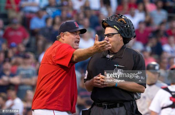 Manager John Farrell of the Boston Red Sox argues a call at first base with home plate umpire Gary Sederstrom during a game against the New York...