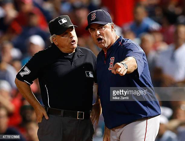Manager John Farrell of the Boston Red Sox argues with first base umpire Larry Vanover in the seventh inning during the game against the Atlanta...
