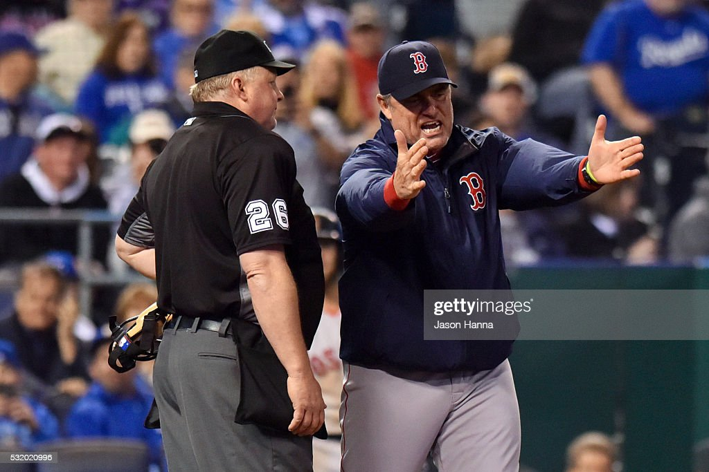 Manager John Farrell #53 of the Boston Red Sox argues with home plate umpire Bill Miller #26 after being ejected during the bottom of the seventh inning game against the Boston Red Sox at Kauffman Stadium on May 17, 2016 in Kansas City, Missouri.