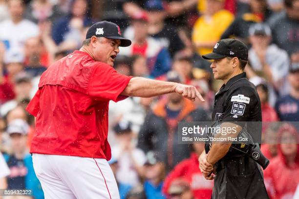 Manager John Farrell of the Boston Red Sox argues with home plate umpire Mark Wegner during the second inning of game four of the American League...