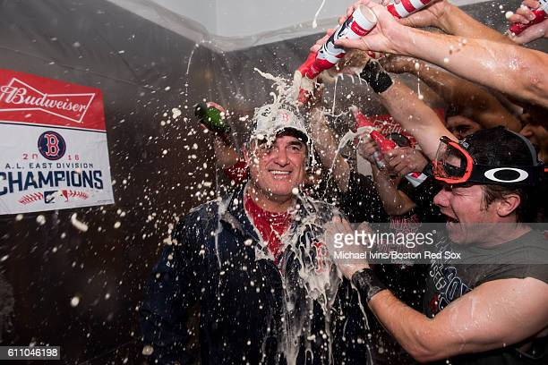 Manager John Farrell of the Boston Red Sox celebrates with teammates after the Red Sox clinched the American League East on September 28 2016 at...