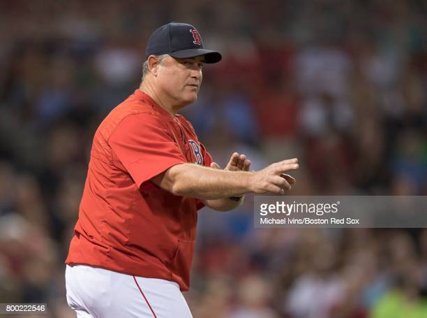 Manager John Farrell of the Boston Red Sox gestures towards the bullpen for a pitcher change against the Los Angeles Angles of Anaheim in the sixth...