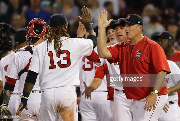 Manager John Farrell of the Boston Red Sox high fives Hanley Ramirez after defeating the Houston Astros 103 in game three of the American League...