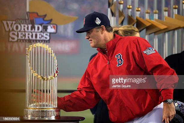 Manager John Farrell of the Boston Red Sox holds the World Series trophy after defeating the St Louis Cardinals 61 in Game Six of the 2013 World...