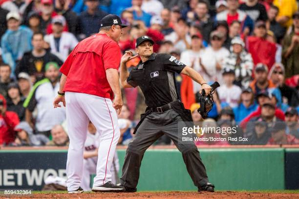 Manager John Farrell of the Boston Red Sox is ejected from the game after arguing with home plate umpire Mark Wegner during the second inning of game...
