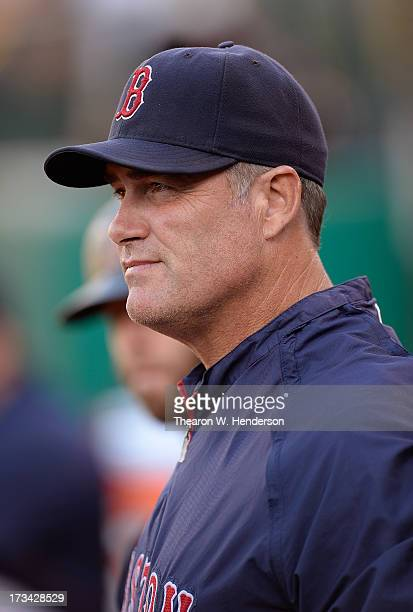 Manager John Farrell of the Boston Red Sox looks on from the dugout against the Oakland Athletics at Oco Coliseum on July 12 2013 in Oakland...