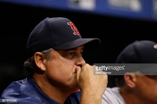 Manager John Farrell of the Boston Red Sox looks on from the dugout during the fifth inning of a game against the Tampa Bay Rays on August 8 2017 at...