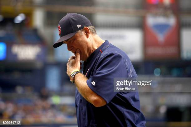 Manager John Farrell of the Boston Red Sox makes his way back to the dugout after checking on Xander Bogaerts who was hit with a pitch by Jacob Faria...