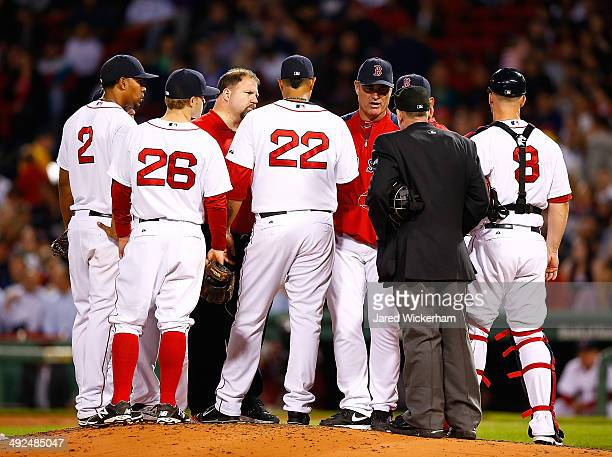 Manager John Farrell of the Boston Red Sox pulls Felix Doubront because of an apparent injury in the fifth inning against the Toronto Blue Jays...