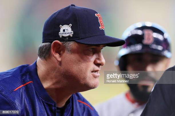 Manager John Farrell of the Boston Red Sox reacts during game one of the American League Division Series between the Boston Red Sox and the Houston...