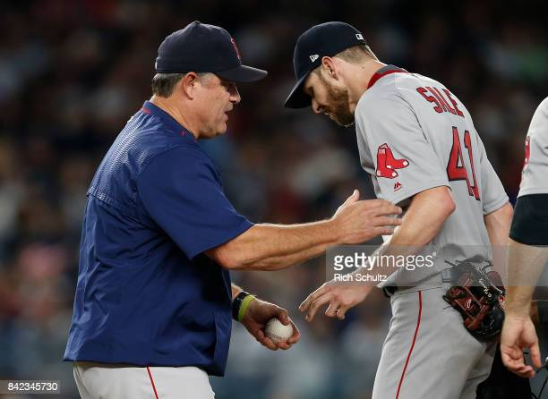Manager John Farrell of the Boston Red Sox removes pitcher Chris Sale the fifth inning against the New York Yankees during a game at Yankee Stadium...