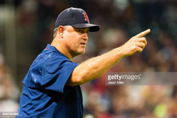 Manager John Farrell of the Boston Red Sox signals to the bullpen for a pitching change during the sixth inning against the Cleveland Indians at...