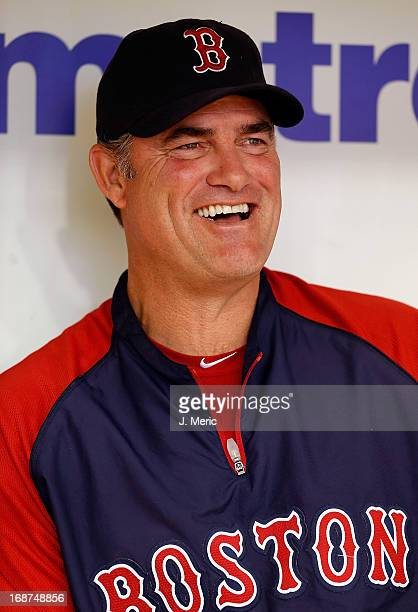 Manager John Farrell of the Boston Red Sox smiles as he talks with reporters before the start of the game against the Tampa Bay Rays at Tropicana...