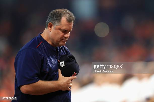 Manager John Farrell of the Boston Red Sox stands during a moment of silence in honor of the victims of the recent Las Vegas shooting before game one...