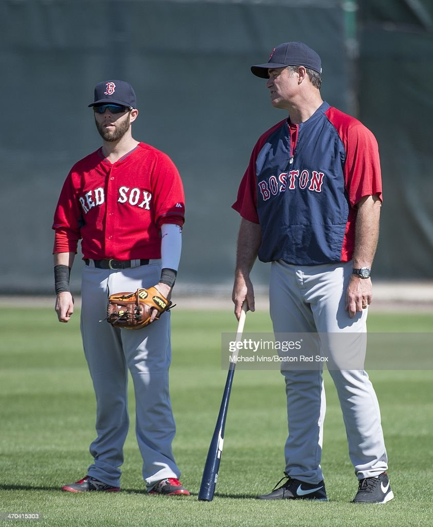 Manager John Farrell #53 of the Boston Red Sox talks with Dustin Pedroia #15 during a Spring Training workout at Fenway South on February 19, 2014 in Fort Myers, Florida.