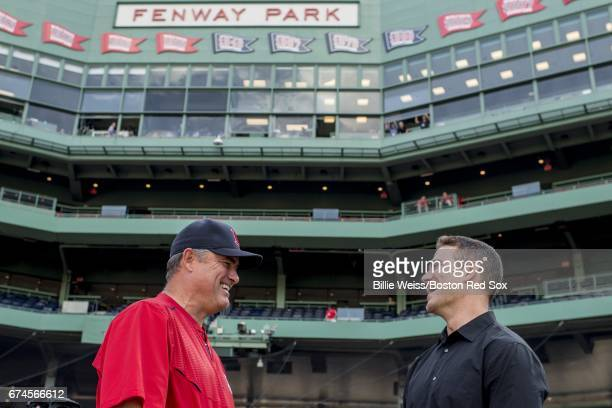 Manager John Farrell of the Boston Red Sox talks with General Manager Theo Epstein of the Chicago Cubs before a game on April 28 2017 at Fenway Park...