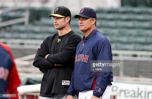 Manager John Farrell of the Boston Red Sox talks with his son infielder Jeremy Farrell of the Pittsburgh Pirates during batting practice just before...