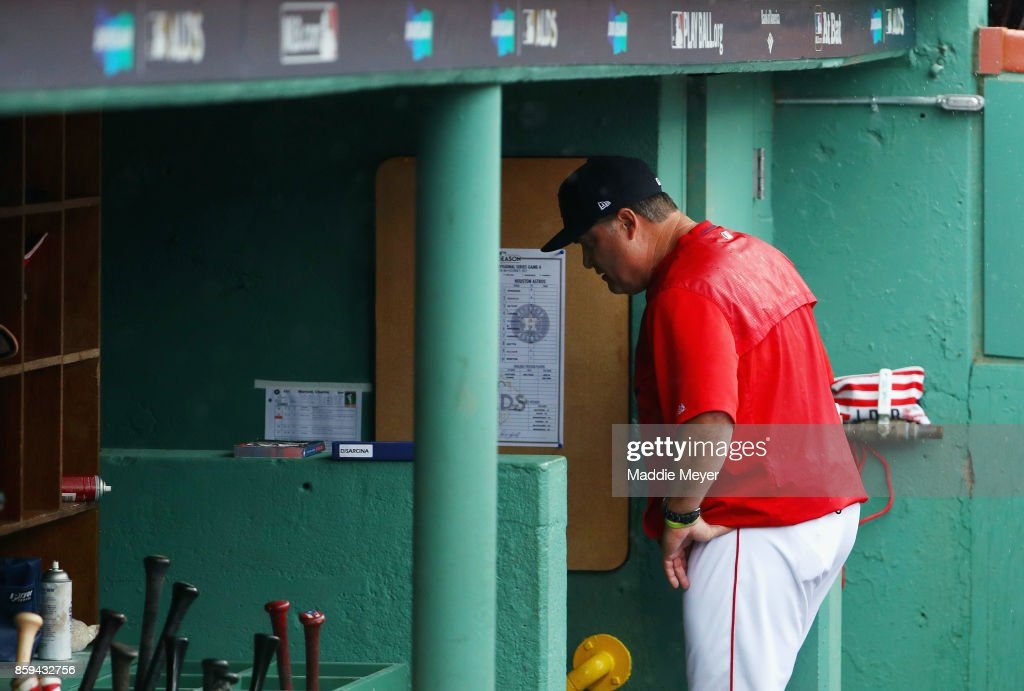 Manager John Farrell of the Boston Red Sox walks through the dugout after being ejected from game four of the American League Division Series against the Houston Astros at Fenway Park on October 9, 2017 in Boston, Massachusetts.