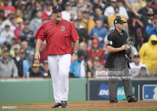 Manager John Farrell of the Boston Red Sox walks towards the dugout after being ejected by home plate umpire Mark Wegner against the Houston Astros...