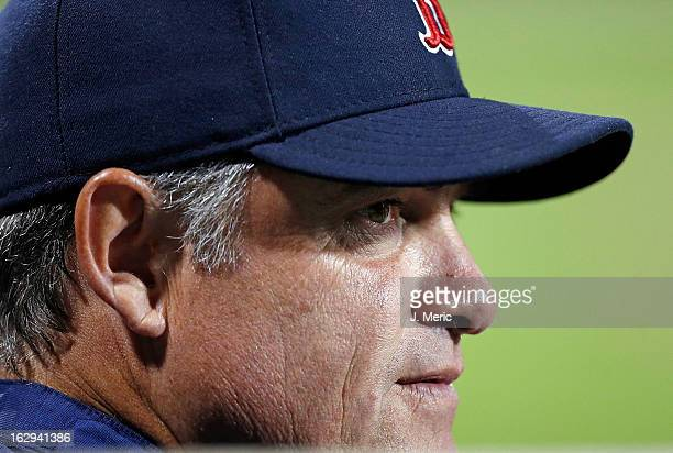Manager John Farrell of the Boston Red Sox watches his team from the dugout against the Pittsburgh Pirates during a Grapefruit League Spring Training...