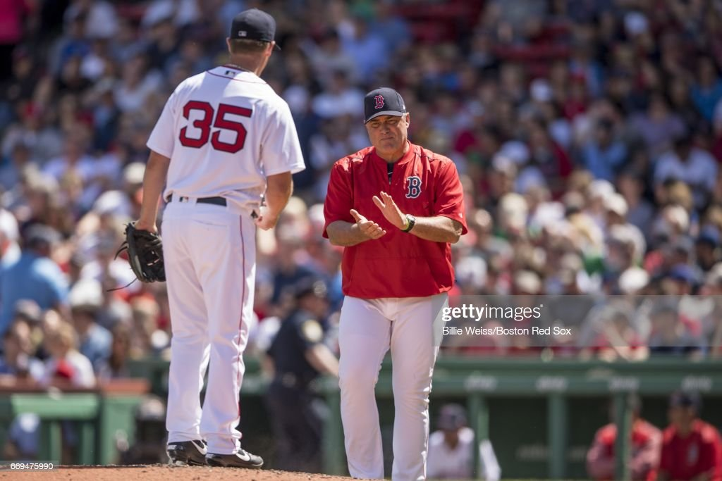 Manager John Farrell reacts as he removes Steven Wright #35 of the Boston Red Sox from the game during the seventh inning against the Tampa Bay Rays on April 17, 2017 at Fenway Park in Boston, Massachusetts.