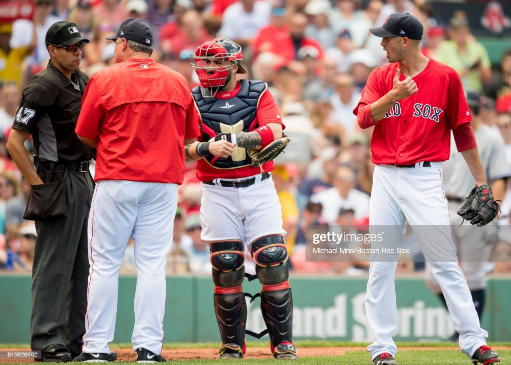 Manager John Farrell #53, Sandy Leon #3 and Rick Porcello #22 of the Boston Red Sox argue with home plate umpire Gabe Morales #47 in the fourth inning of game one of a doubleheader against the New York Yankees at Fenway Park on July 16, 2017 in Boston, Massachusetts.