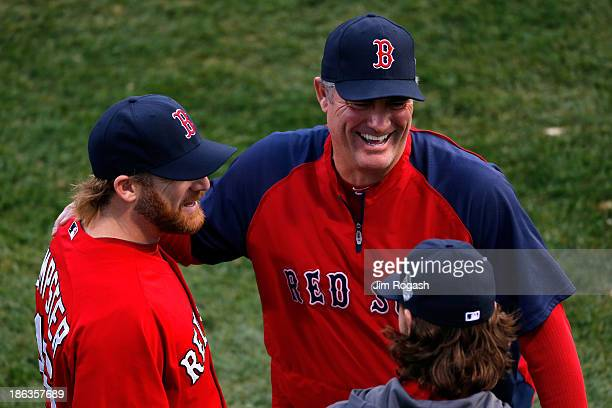 Manager John Farrell speaks with Ryan Dempster and Clay Buchholz of the Boston Red Sox before Game Six of the 2013 World Series against the St Louis...