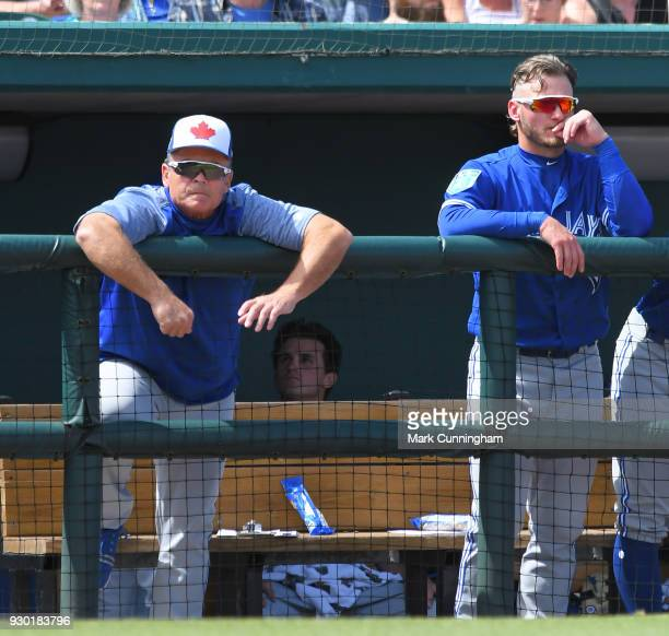 Manager John Gibbons and Josh Donaldson of the Toronto Blue Jays look on from the dugout during the Spring Training game against the Detroit Tigers...