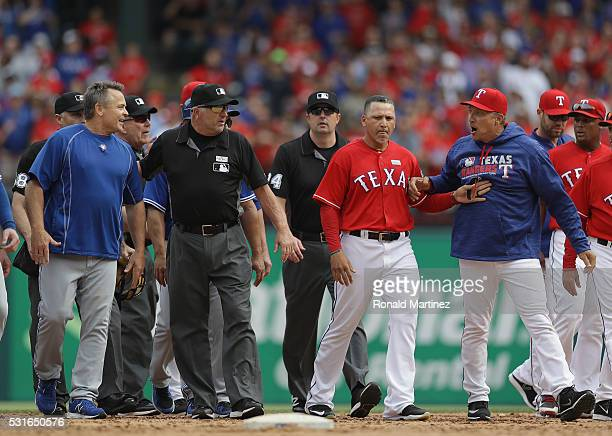 Manager John Gibbons of the Toronto Blue Jays and Manager Jeff Banister yell at each other after the benches cleared in the eighth inning at Globe...